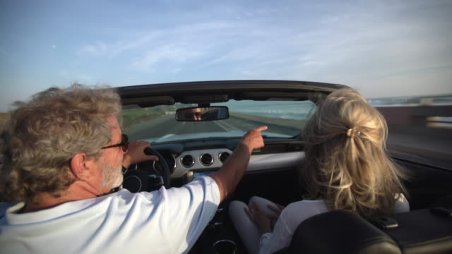 rv mature couple driving in a convertible along the beach - old convertible stock videos & royalty-free footage