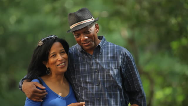 A mature couple enjoy a stroll in New York City's Central Park.