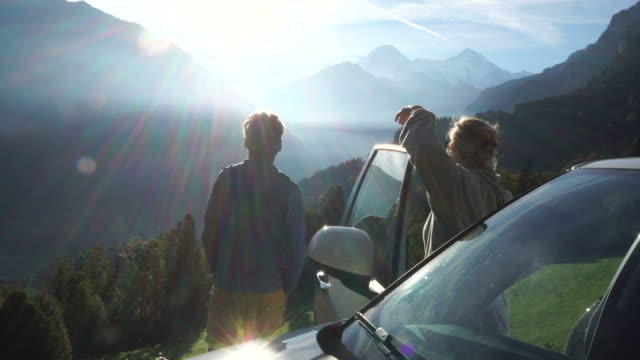 mature couple enjoy mountain view from roadside - roadside stock videos & royalty-free footage