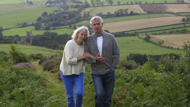 Mature Couple Enjoying a Country Walk