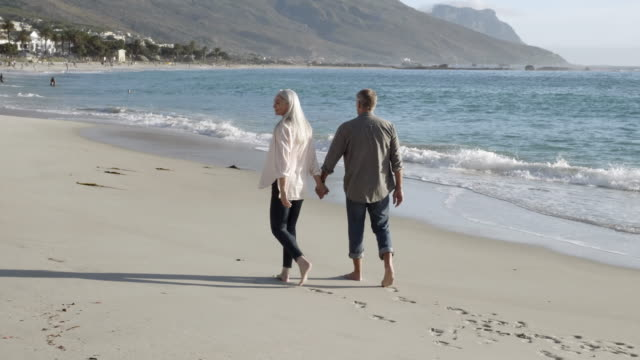 mature couple enjoying vacation at beach - mature couple stock videos & royalty-free footage