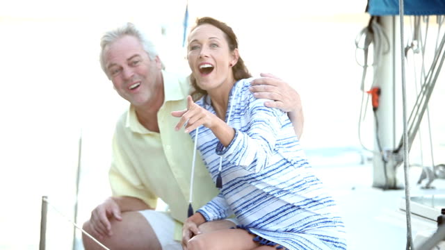 mature couple enjoying view from deck of sailboat - mature couple stock videos & royalty-free footage