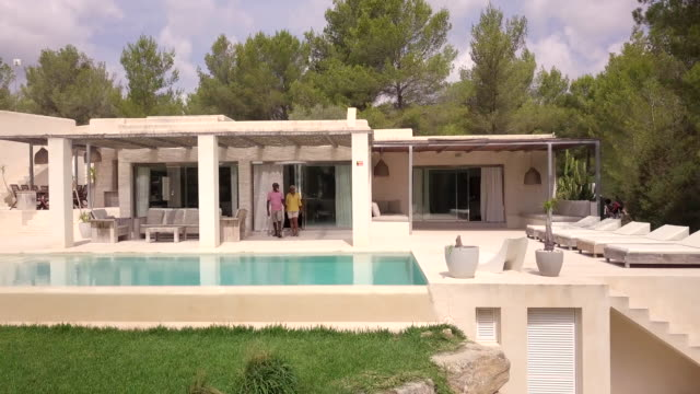 a mature couple exit their spanish holiday villa - reportage stock videos & royalty-free footage