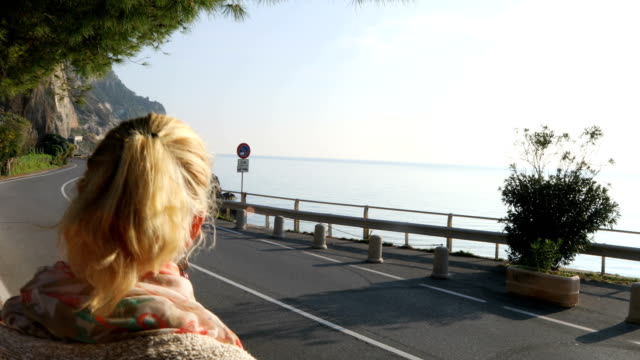 Mature couple explore coastal Mediterranean seafront