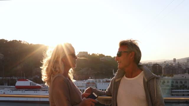 Mature couple explore seafront harbour area of city, Barcelona