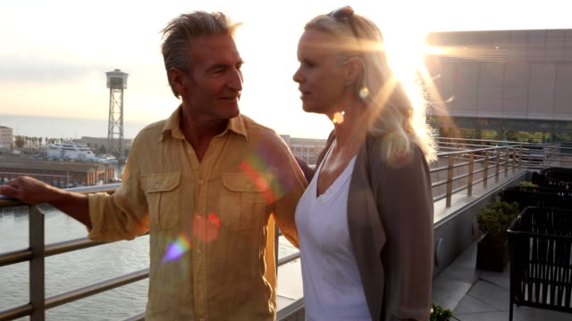 mature couple explore seafront harbour area of city, barcelona - in den fünfzigern stock-videos und b-roll-filmmaterial