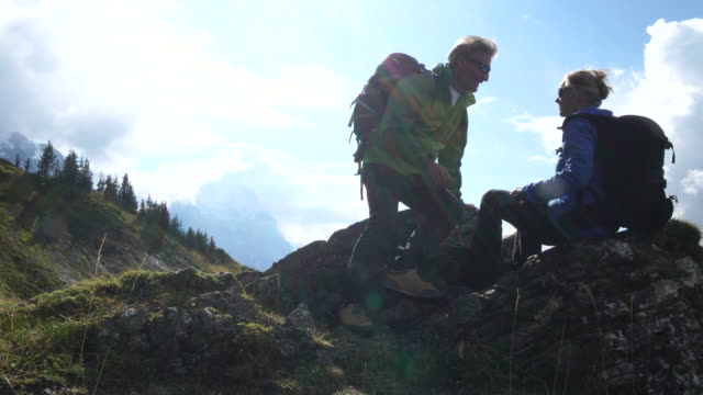 mature couple exploring mountain ridgeline - purity stock videos & royalty-free footage
