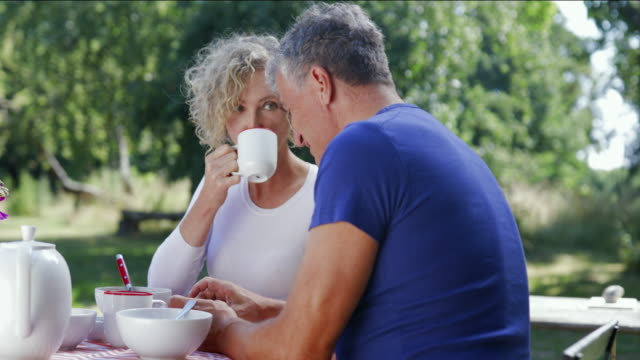 mature couple having a healthy breakfast. - mature couple stock videos & royalty-free footage