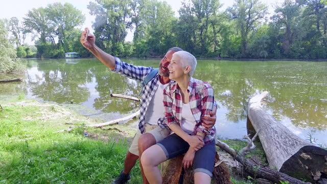 mature couple hiking - three quarter length stock videos & royalty-free footage