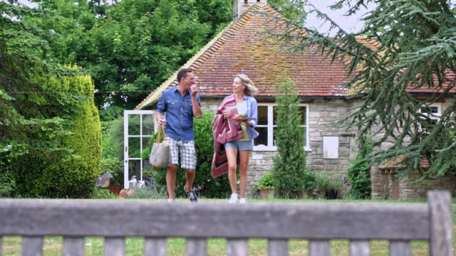 mature couple in garden - blanket stock videos & royalty-free footage