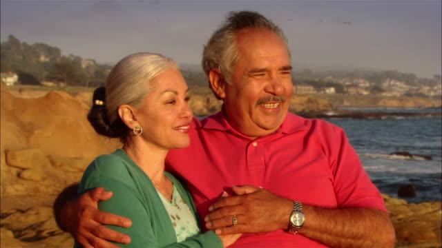 CU, Mature couple in Moonstone Beach, portrait, Cambria, California, USA