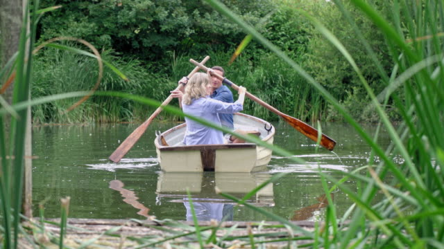 mature couple in rowboat - lake stock videos & royalty-free footage