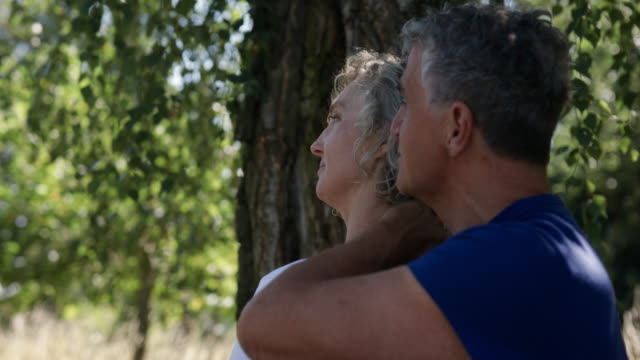 mature couple looking into the sky. - baby boomer stock videos & royalty-free footage