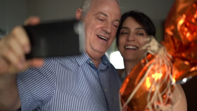 Mature couple making a video chat on the Brazilian Easter