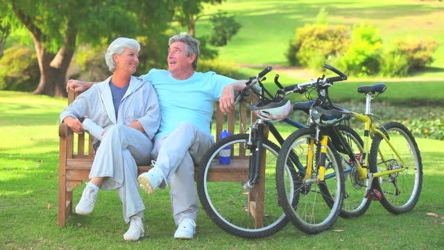 mature couple on a bench / cape town, western cape, south africa - cycling helmet stock videos & royalty-free footage