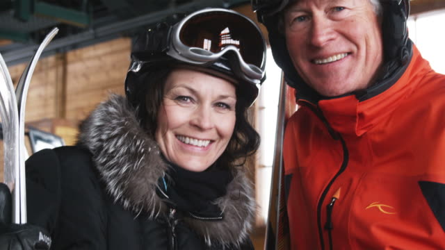 mature couple on a ski holiday - winter sport stock videos & royalty-free footage