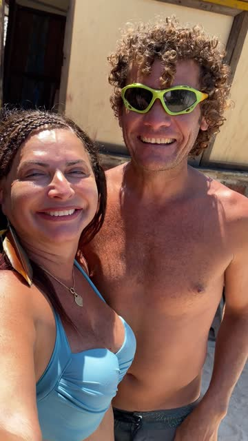 mature couple on a video chat at the beach - long distance relationship stock videos & royalty-free footage