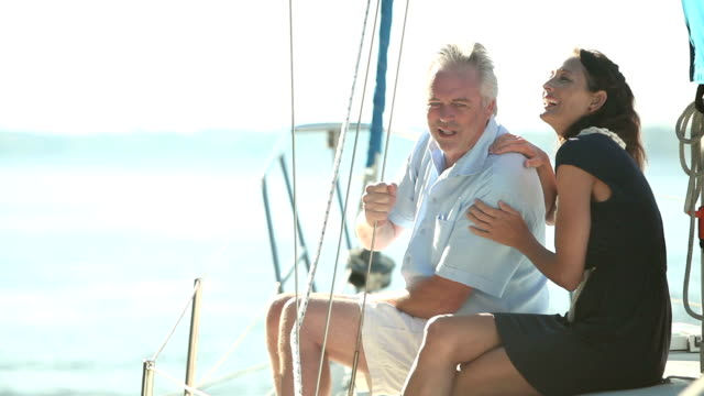 mature couple on deck of sailboat, talking, relaxing - 40 44 years stock videos & royalty-free footage