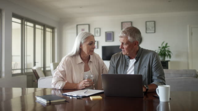 mature couple planning home finances - mature men stock videos & royalty-free footage