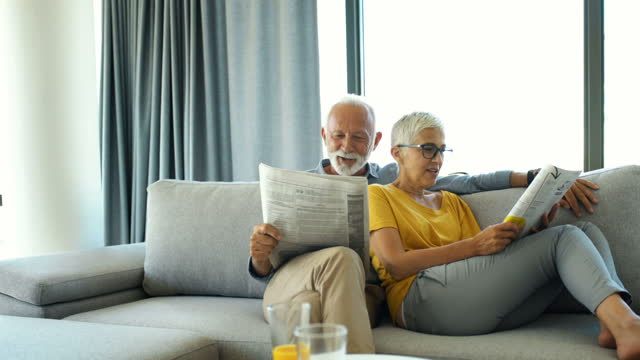 mature couple reading magazines and having a conversation. - magazine stock videos & royalty-free footage