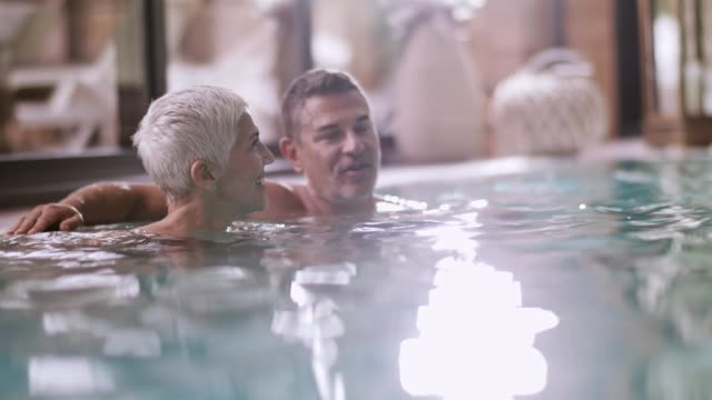 mature couple relaxing at spa pool - mature couple stock videos & royalty-free footage