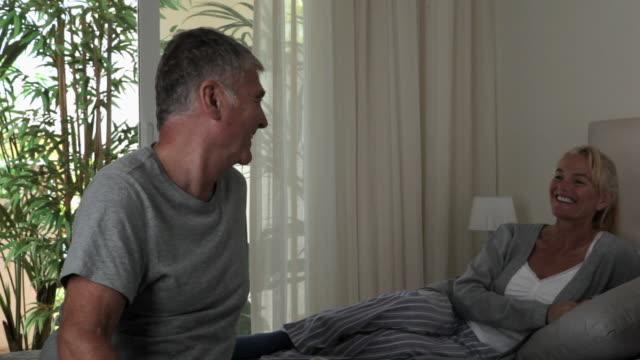 stockvideo's en b-roll-footage met mature couple relaxing in bedroom - dubbel bed