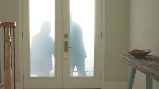 mature couple returning home from work - front door stock videos & royalty-free footage