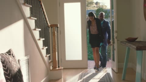 mature couple returning home from work - after work stock videos & royalty-free footage