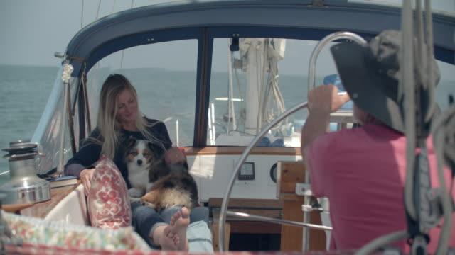 mature couple sailing on her sailboat - ehemann stock-videos und b-roll-filmmaterial