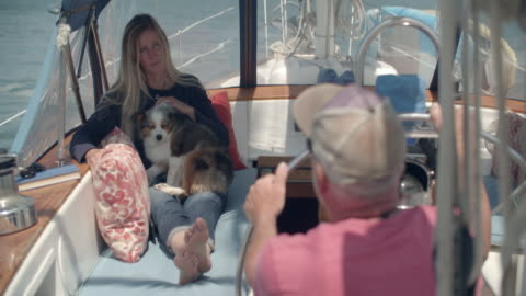 mature couple sailing together on a sailboat - husband stock videos & royalty-free footage