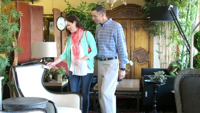mature couple shopping in furniture store - price tag stock videos & royalty-free footage