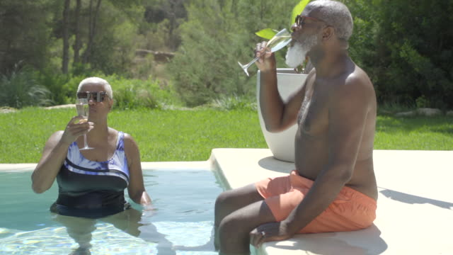 a mature couple sip champagne on holiday - mature couple stock videos & royalty-free footage