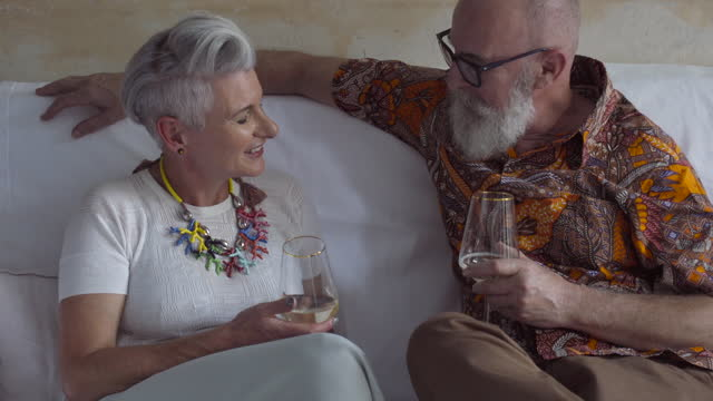 a mature couple toast each other - grey hair stock videos & royalty-free footage