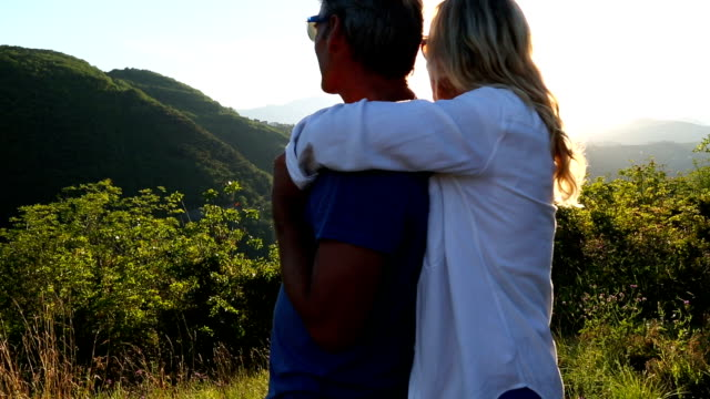 mature couple walk onto hilltop field - blonde hair stock videos & royalty-free footage