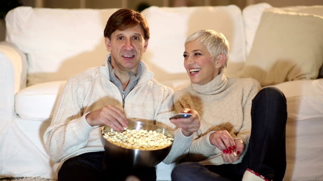 Mature couple watching TV for Christmas