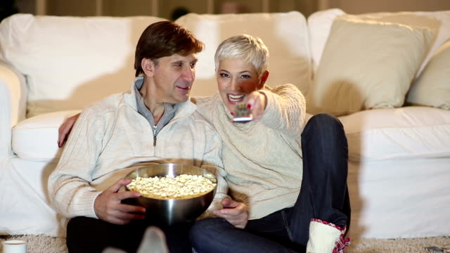 mature couple watching tv for christmas - beautiful people stock videos & royalty-free footage