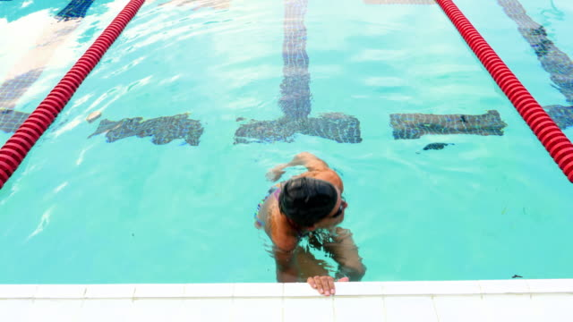 ms ha mature female athlete swimming during morning workout - 50 54 jahre stock-videos und b-roll-filmmaterial