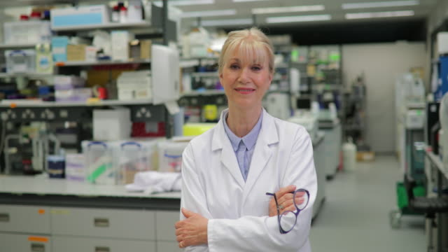 mature female bio chemist in a lab - scientist stock videos & royalty-free footage