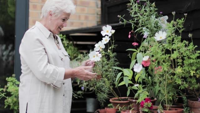 Mature female gardening