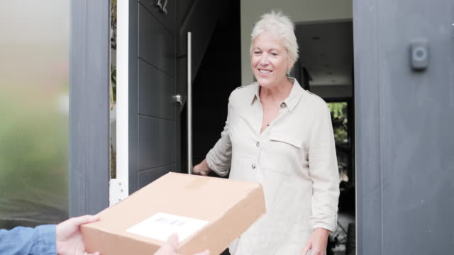 mature female receiving home delivery - receiving stock videos & royalty-free footage