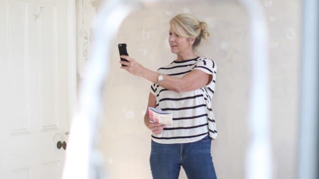 mature female using visualiser room application - examining stock videos & royalty-free footage