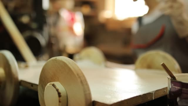 mature female woodworker in her workshop - wood stain stock videos & royalty-free footage