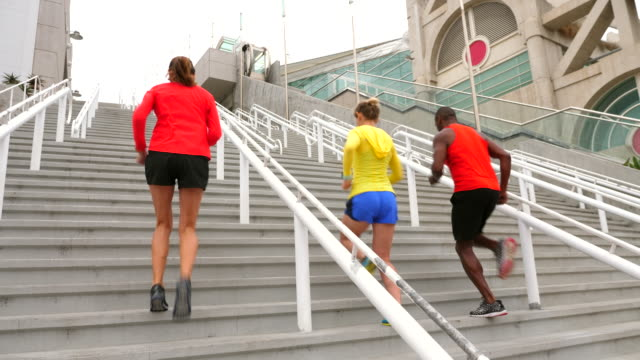 ms mature friends running stairs together during workout - kleine personengruppe stock-videos und b-roll-filmmaterial