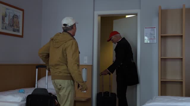 mature gay couple entering hotel suite together - bathrobe stock videos & royalty-free footage