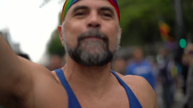 mature gay man dancing on gay parade - 50 54 years stock videos & royalty-free footage