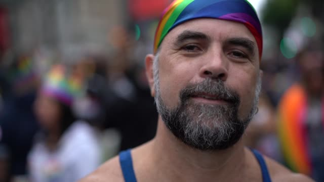 mature gay man on gay parade - human rights stock videos and b-roll footage