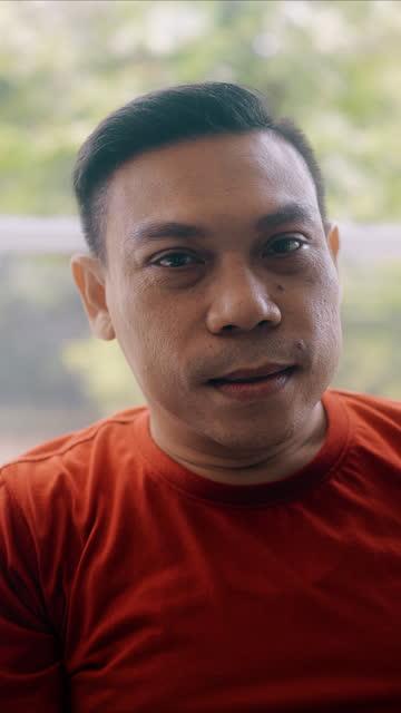vídeos de stock e filmes b-roll de mature gay man portrait. confidence, vertical shot. - one mature man only