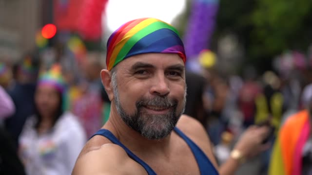 mature gay man taking a selfie at gay parade - parade stock videos & royalty-free footage
