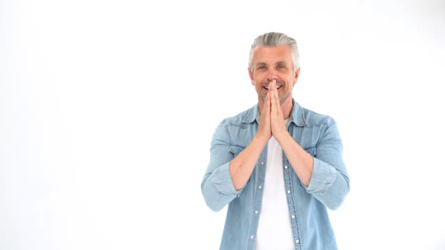 mature guy looking very surprised and happy finishing with arms crossed - uomo maturo video stock e b–roll