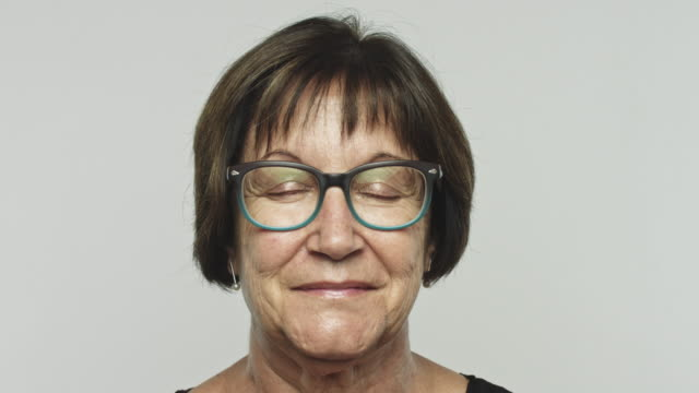 Mature happy woman opening eyes